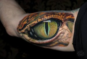 """Retile eye tattoo for men inner bicep"""