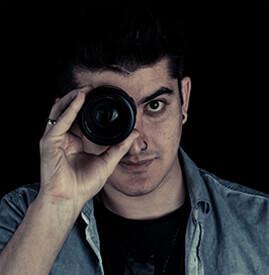 """Guy looking through camera lens"""